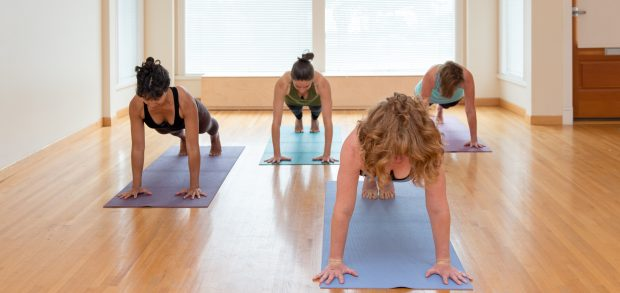 four woman in yoga plank.